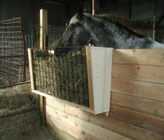 Homemade stall hay feeder. That one needs a lid to keep the neighbor out but otherwise I like it.