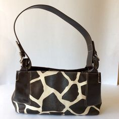 "NINE & CO Animal Print Purse Nine & Co. Brown and Off White Animal print Shoulder Bag. Inside had 4 separate compartments with 1 zippered and side zippered pocket & 2 slide in spaces. Gently used. MEASUREMENTS: 12"" x 4"" x 7 1/2"" and Shoulder drop is 12"". Nine West Bags Shoulder Bags"