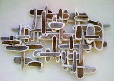 Leo Bersamina : Sculpture/Installation. Edge-painted driftwood pieces.