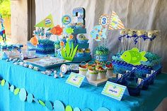 """Dessert table with the cake, """"bait"""" pails, jello cups, and other yummies."""