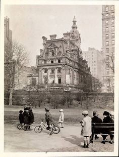 Children playing at Central Park; in the distance is the Clark mansion (NYC, ca. 1910s)
