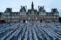 Diners dressed in white take part in a Diner en Blanc event in Paris, France