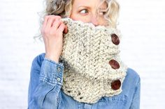 """This free crochet cowl pattern uses the herringbone double crochet stitch to create a deliciously chunky scarf with a modern look! The oversized buttons add another element that is endlessly customizable. Pictured in Lion Brand Wool-Ease Thick & Quick in """"Oatmeal."""""""