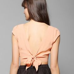 Tie back capsleeve crop top This is a great little statement piece by Pins and Needles purchased at Urban Outfitters.  Beautiful peachy color, cap sleeve, tie back, crop top in a lightweight crepe material.  Perfect over highwaisted jeans, a skater skirt, or as a topped for a dress or bathing suit. Urban Outfitters Tops Crop Tops
