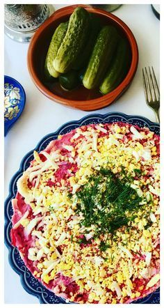 A classic Russian winter recipe popular especially during New Year celebrations. A layered salad with beets potatoes carrots eggs herring and lots of mayonnaise! Its like a crazy potato salad! - Shuba Salad or Herring Under a Fur Coat (Селёдка под шубой)