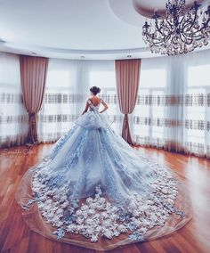 What a spectaular train on this wedding gown! The surf of white blossoms against the sea of the dress trailing behind the bride is simply breathtaking. See more wedding gowns on Wedding Vows. Quince Dresses, Prom Dresses, Formal Dresses, Evening Dresses, Light Blue Quinceanera Dresses, Ball Gown Dresses, Dress Prom, Elegant Dresses, Bridal Dresses