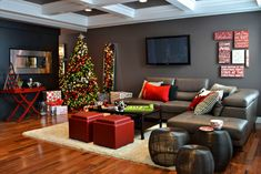 This contemporary living space transforms with the holidays by enhancing their red accents and choosing simple holiday decor. - Homes for the Holidays Edmonton contemporary living room Christmas Interiors, Christmas Living Rooms, Christmas Room, Modern Christmas, Christmas Design, Beautiful Christmas, Swedish Christmas, Christmas Christmas, Christmas Ornaments