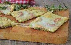 Schiacciata di zucchine una ricetta con una base di solo zucchine, farcita con prosciutto e formaggi, ideale come aperitivo,antipasto e cenetta sfiziosa