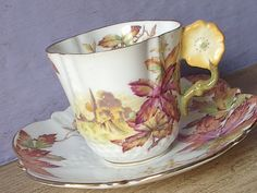 Antique 1920's Aynsley flower handle demitasse tea cup and saucer.