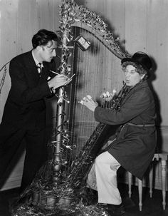 Harpo Marx 'playing' the Barbed Wire Harp -  a Christmas present from Salvador Dalí, 1937 (brotp!! click to read this darling article about them)