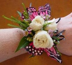 White Spray Roses, Rhinestones, & Waxflower Wrist Corsage. Fly High Beautiful Butterfly! 820 South 8th Street, Historic District, downtown Manitowoc Email: info@thewildiris.net   920-682-6194   http://www.thewildiris.net/homecoming     #TheWildiris #florists #flowers #HomecomingFlowers #Homecoming2015 #Manitowoc  (scheduled via http://www.tailwindapp.com?utm_source=pinterest&utm_medium=twpin&utm_content=post13624714&utm_campaign=scheduler_attribution)