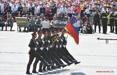 The Color Guard of the Lao People's Army Guard of Honor marching through Tiananmen Square in Beijing at the 2015 Chinese V-J Day Parade.