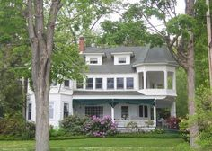 Lake front Victorian in Chautauqua, NY. Love the upper story porch.