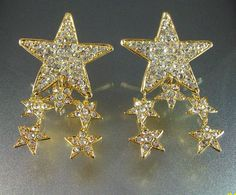 These Vintage 1980s Rhinestone Star Runway Statement Clip Earrings are offered for your consideration. The door knocker pair are number signed