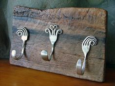 One of the ways to recycle old cutlery in home decor is bending and curving old forks and spoons giving them the shape of a hook.