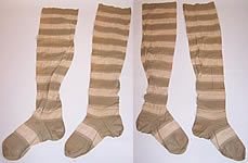 This antique Victorian era ladies green and white striped tree thigh high garter stockings socks date from 1900. They are made of a sage grayish green color and off white striped cotton knit fabric, with decorative pierced cut work designs of Christmas pine trees. These unusual ladies long thigh high garter stockings socks have a seamed back and toes.
