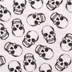 """off-white 'tossed skulls' skull fabric by Timeless Treasures """"Halloween collection"""""""