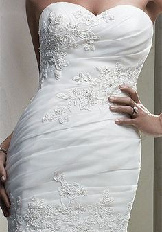 This beautiful Casablanca dress has never been worn or tried on! The sweetheart neckline and mermaid style makes this dress very elegant. The re-embroidered lace and Swarovski crystal appliques add mu