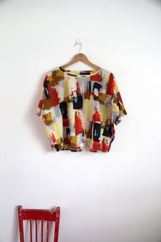 Abstract cotton voile batwing sleeve top.