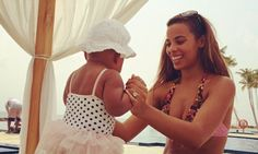Life's a beach: The Saturdays' Rochelle Humes and baby Alaia-Mai enjoy quality family time on exotic holiday