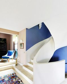 Modern staircase in foyer with blue and white walls