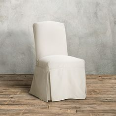 View the Alaina Slipcovered Chair (30ALAINA) from Arhaus. Subtle, chic and sophisticated, this delightful Parsons style silhouette dresses up for di