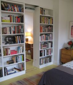 Sliding bookcase. Would love if it lead to an office or study