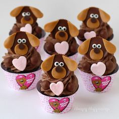 """Say """"I Woof You"""" with these adorable Puppy Dog Cupcakes this Valentine's Day. Check out HungryHappenings.com for the instructions."""