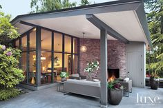 The covered outdoor room is quintessential Northwest Modern, with the roof's overhangs allowing the owners to enjoy the mild climate year round.