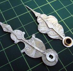 DIY Clock Hands - Just adhere your design to plain clock hands. (Scrapbook paper, other paper, etc.)
