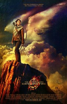 """The first official poster for Catching Fire with a quote from the novel: """"The sun persists in rising, so I make myself stand."""" I love how the clouds are giving her wings!"""