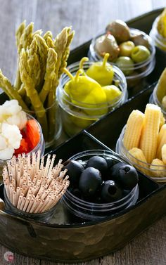 Do you remember having relish trays at parties? Check out my modern twist on an old-fashioned relish tray and watch it become your new favorite finger food! Thanksgiving Fruit, Thanksgiving Appetizers, Appetizers For Party, Thanksgiving Celebration, Pickled Olives, Charcuterie And Cheese Board, Relish Trays, Easter Dinner