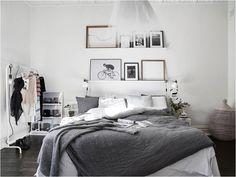 Dark floors, grey and white bedding.