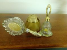 Silk and Honey bath gel (4.5 oz). honey-colored, hive-shaped jar with lid (bee handle missing) and spoon. Avon Collectibles - Set of 3. Clear glass bell (1 oz.)., contained Unforgettable cologne.   eBay!