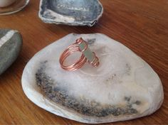 Copper wire wrapped seaglass ring (L) on Etsy, £10.00