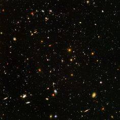 Hubble Ultra Deep Field. One of the most amazing photos of space I've ever seen--a view of nearly 10,000 galaxies.   http://www.spacetelescope.org/images/heic0406a/