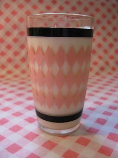 I used to have a set of pink and black Hazel Atlas dishes. These glasses would have looked great with them!  Vintage Hazel Atlas pink diamond and black striped drinking glass...