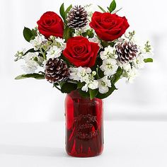 Reminiscent of pinecones freshly covered in snow, our Let It Snow bouquet is a winter wonderland of frosted pinecones, red roses, white spray stock and greens.