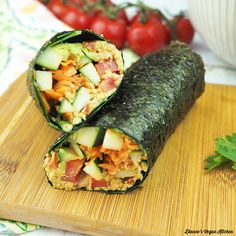 Loaded with veggies and an easytomake sunflower seed cheese raw vegan Sushi Wraps are a deliciously light meal for warm summer days Vegan Sandwich Recipes, Sushi Recipes, Raw Vegan Recipes, Vegetarian Sandwiches, Vegan Food, Healthy Asian Recipes, Healthy Eats, Sushi Wrap, Vegan Wraps