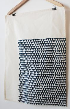 negative space tea towel >>  Ooh, off-set repeat pattern. Single color, single print?