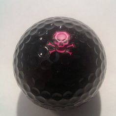 Pink Skulls Logo on a Black Golf Ball with Plastic Case by Adamo Golf on Opensky
