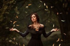 Photo about A beautiful witch, magic is circling autumn leaves. Image of elegant, adult, groom - 104206092 Halloween Photography, Fantasy Photography, Artistic Photography, Photographie D' Halloween, Halloween Fotografie, Dark Autumn, Autumn Witch, Religion Wicca, Shaman Woman