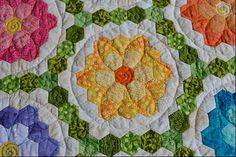 mn quilts. Idea for quilting pattern for grandmother's flower garden pattern. Also, love the idea of print for the green