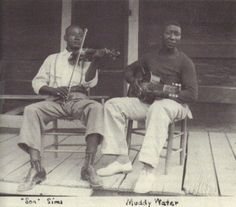 Muddy Waters and Son Sims playing on porch at Stovall Plantation