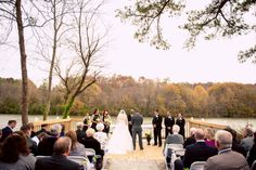 The gorgeous view of the ceremony + the river. ::Ashley + Daniel's striking fall wedding at the Roswell River Landing in Georgia:: #georgiawedding #wedding #photography #ceremony #outdoorwedding