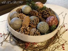 Bowl filled with pine cones, pine, and rag balls for Christmas.