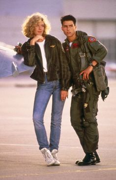 "Tom Cruise ( Maverick ) and Kelly McGillis (Charlie) in ""Top Gun"" (1986). ""Take me to bed or lose me forever."""