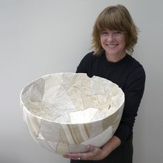 Zoë Hillyard is known for creating 'ceramic patchwork', an innovative process whereby broken ceramics are re-constructed using fabric and hand-stitch.