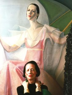 Diana Vreeland sitting in front of her famous portrait by William Acton