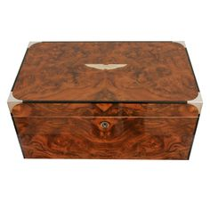 Walnut & sterling silver cigar humidor. A tight seal keeping the humidity at the perfect level.